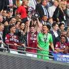 John McGinn lifts the trophy after Aston Villa won the playoff for promotion to the English...