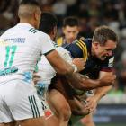Ben Smith struggles in the tackle during an epic 31-31 draw against the Chiefs at Forsyth Barr...