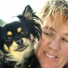 Chucky and owner Carrie-Anne Caley have been reunited after a tug of war over the young Chihuahua...