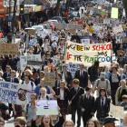 Striking high school pupils and supporters march up George St to the Octagon last Friday to...