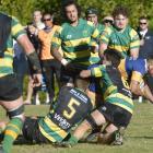 Taieri's Te-Korohi Rupene crashes through the Green Island defence to score during a Dunedin...