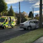 A white sedan crashed into a power pole, leaving its front driver's door crumpled and its...