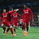 Divock Origi celebrates Liverpool's fourth goal which put it ahead in the Champions League...