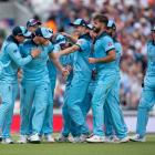 England celebrates a run out during its win over South Africa in this morning's World Cup opener...