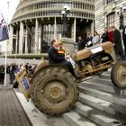 National MP Shane Ardern drives his tractor ``Myrtle'' up the steps of Parliament in September...