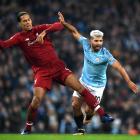 Liverpool's Virgil van Dijk tackles Manchester City's Sergio Aguero earlier in the season. Photo:...