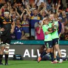 Matt Faddes (right) and Aaron Smith of the Highlanders celebrate their late win over the Chiefs...