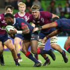 The Rebels' Marika Koroibete runs the ball up against the Reds. Photo: Getty Images