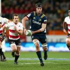 Tom Franklin stretches his legs in the Highlanders' 39-27 point win over the Lions tonight. Photo...