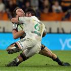 Ben Smith falls awkwardly in the tackle of Chiefs loose forward Luke Jacobson during Saturday's...
