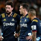 Elliot Dixon, Ben Smith and Aaron Smith ponder a situation during the Highlanders' match against...