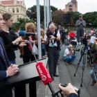 Education Minister Chris Hipkins fronting thousands of striking teachers, and their supporters,...