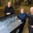 At the University of Otago's Central Library are (from left) Speedy Signs business development...