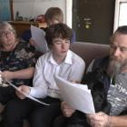 The Lambert family - Stephanie Logan, Cairo and Chris - look through documents about their...