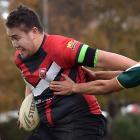 Dunedin Bears player Jimmy Eteuati is held by Tipene Maddams, of Invercargill club Cooks,  during...