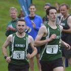 Aaron Anderson (left) and Ben Lund are neck and neck as they start the final lap of the social...