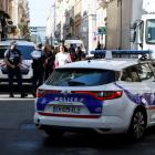 Police patrol the streets at the weekend during the manhunt of a suspected suitcase bomber in...
