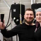 Partners Chris Noye and Sarah Williams in their craft brewery which uses local ingredients. PHOTO...