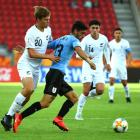 Emiliano Ancheta of Uruguay and Willem Ebbinge of New Zealand compete for the ball during their...