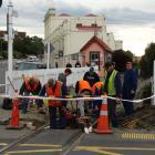 Oamaru Steam and Rail Society volunteers work to prepare for the installation of sensors and...
