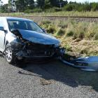 Damage to a car after it was hit by a train at a rail crossing at the intersection of...