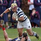 Otago Boys High School first five-eighth Tevita Asi is tackled by John McGlashan College hooker...