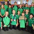 Seeking information on the mystery tray recently sent to Maheno School are pupils (back, from...