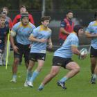 Action from today's premier match between University and Dunedin at Logan Park. Photo: Gerard O...