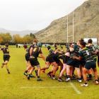 Mt Aspiring College halfback Ethan Kerr clears from a scrum near Wakatipu High School's line...