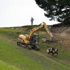 Contractors remove a quad bike from a Waihola farm in September 2014, after it was involved in an...