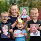 Putting on their best royal poses are (clockwise, from left) George, Charlotte, Harry and Archie...