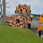 Police at the scene of an accident involving a logging truck at Maia this morning. Photo: Gerard...