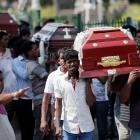 Coffins are carried during a Mass for victims, days after a string of suicide bomb attacks on...