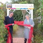 Otago Community Hospice chief executive Ginny Green and Mitre 10 Mega chief executive Neil Finn...
