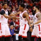 Norman Powell, Kyle Lowry and Fred van Vleet high five during the Toronto Raptors conference...
