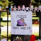 A poster hangs at a memorial site in front of Christchurch Botanic Gardens for victims of the...