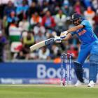 Rohit Sharma plays a shot on his way to a century against South Africa. Photo: Reuters