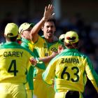Australia's Mitchell Starc celebrates with teammates after taking the wicket of West Indies'...