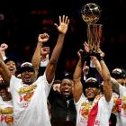 """Toronto Raptors players celebrate with the Larry O""""Brien Trophy after beating the Golden State..."""