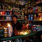 A vendor waits for customers during a national blackout in Buenos Aires, Argentina. Photo: Reuters