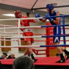 Awatea Henry (right) throws a punch against Reece Holz, of Gore, in the final of the 69kg youth...
