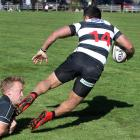 Crescent winger Fesui Viliamu is upended by Clinton loose forward Greg Landels at a club match in...
