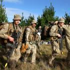 The Christchurch team from 2/4 RNZIR NZ Army Reserve Force carries its casualties away from a...