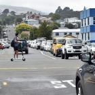Traffic queues at the intersection of Clyde and Albany Sts yesterday, where a trial roundabout is...