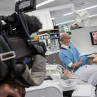 Trying it out … TV One reporter John McKenzie is filmed by cameraman Ross Wilson as Faculty of...