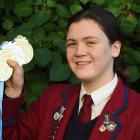 Kavanagh College pupil Erika Fairweather (15) with her medals from the national open swimming...