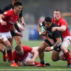 Etene Nanai-Seturo is tackled by Ben Warren in New Zealand's loss to Wales this morning at the...