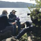 Neil Gemmell (centre) on the shores of Loch Ness. PHOTO: Supplied