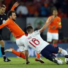 Netherlands' Davy Propper of Holland (L) vies for the ball with England's Declan Rice during...