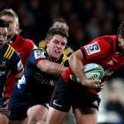 George Bridge evades the tackle of Tei Walden as Rob Thompson chases during the Crusaders win...